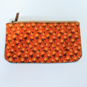 Fossil coated canvas pouch